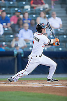 Kelby Tomlinson (1) of the Richmond Flying Squirrels follows through on his swing against the Bowie Baysox at The Diamond on May 23, 2015 in Richmond, Virginia.  The Baysox defeated the Flying Squirrels 3-2.  (Brian Westerholt/Four Seam Images)