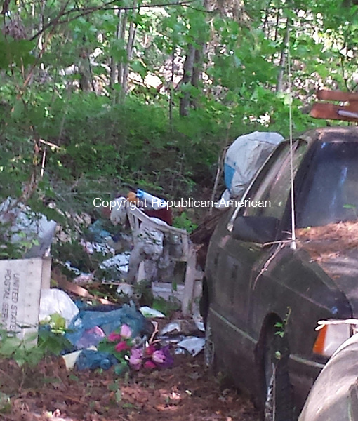 CHESHIRE, CT - June 15, 2014 - 06152014LX06 - A woman who lived in this home on Winslow Street may have died when the floor of her kitchen collapsed.