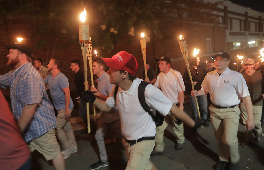 Members of the Alt-Right led a torch march thru the grounds of the University of Virginia Friday night in Charlottesville, Va. Photo/Andrew Shurtleff/The Daily Progress