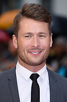 """Glen Powell<br /> arriving for the world premiere of """"The Guernsey Literary and Potato Peel Pie Society"""" at the Curzon Mayfair, London<br /> <br /> ©Ash Knotek  D3394  09/04/2018"""