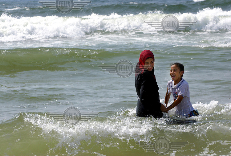 Two girls playing in the sea.