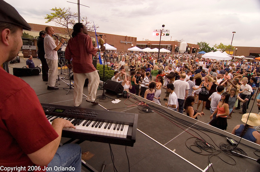 Members of the Ricardo Lemvo mand Makina Loca Band perform at the SOBO Summerfest in Boulder, CO on June 3rd, 2006.