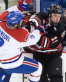 Chad Ruhwedel (Lowell - 3), Brodie Reid (Northeastern - 15) - The visiting Northeastern University Huskies defeated the University of Massachusetts-Lowell River Hawks 3-2 with 14 seconds remaining in overtime on Friday, February 11, 2011, at Tsongas Arena in Lowelll, Massachusetts.