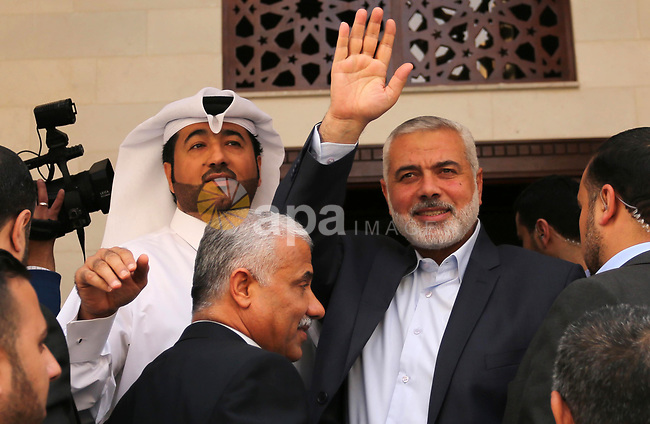 Senior political leaders of the Islamist movement, Ismail Haniyeh attends the opening ceremony of Sheikh Hamad's mosque, in Khan Younis in the southern Gaza strip, on April 10, 2017. Photo by Ashraf Amra