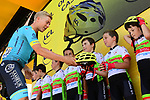 Michael Valgren (DEN) Astana Pro Team hands out helmets to the youth riders at sign on before the start of Stage 4 of the 2018 Tour de France running 195km from La Baule to Sarzeau, France. 10th July 2018. <br /> Picture: ASO/Alex Broadway | Cyclefile<br /> All photos usage must carry mandatory copyright credit (&copy; Cyclefile | ASO/Alex Broadway)