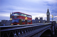Night Bus Crossing at Parliament. Night Time Bus in London. Dusk at Parliament.