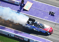 Apr. 28, 2012; Baytown, TX, USA: Aerial view of NHRA funny car driver Bob Tasca III during qualifying for the Spring Nationals at Royal Purple Raceway. Mandatory Credit: Mark J. Rebilas-
