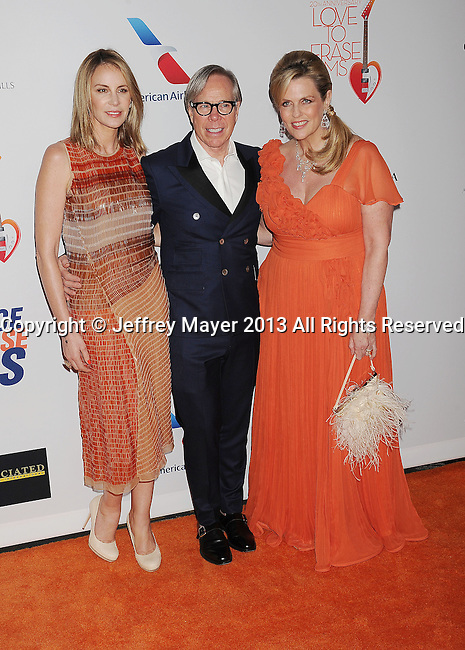 CENTURY CITY, CA- MAY 03: Dee Ocleppo Hilfiger, designer Tommy Hilfiger and Nancy Davis arrive at the 20th Annual Race To Erase MS Gala 'Love To Erase MS' at the Hyatt Regency Century Plaza on May 3, 2013 in Century City, California.