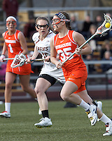 Syracuse University attacker Michelle Tumolo (35) on the attack.   Syracuse University (orange) defeated Boston College (white), 17-12, on the Newton Campus Lacrosse Field at Boston College, on March 27, 2013.