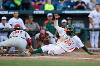 Miami Hurricanes outfielder Jacob Heyward (24) slides home during the NCAA College baseball World Series against the Arkansas Razorbacks  on June 15, 2015 at TD Ameritrade Park in Omaha, Nebraska. Miami beat Arkansas 4-3. (Andrew Woolley/Four Seam Images)