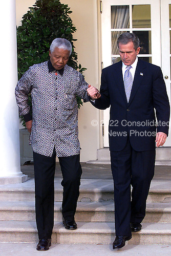 Washington, DC - November 12, 2001 -- United States President George W. Bush holds a media availability outside of the Oval Office to offer condolences to the families of those killed in the crash of American Airlines flight 587 in New York on Monday, November 12, 2001.  This followed a meeting with former South African President Nelson Mandela..Credit: Ron Sachs / CNP