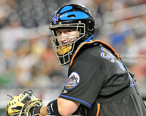 Washington, D.C. - August 13, 2008 -- New York Mets catcher Brian Schneider (23) looks towards the dug-out as he prepares to catch in the ninth inning against the Washington Nationals at Nationals Park in Washington, D.C. on Wednesday, August 13, 2008.  The Mets won the game 12 - 0..Credit: Ron Sachs / CNP.(RESTRICTION: NO New York or New Jersey Newspapers or newspapers within a 75 mile radius of New York City)