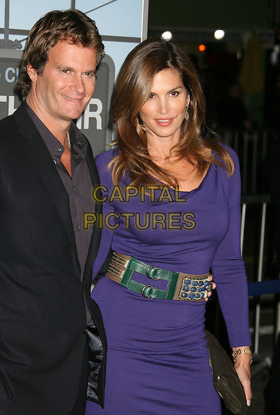 "RANDE GERBER & CINDY CRAWFORD.The ""Up In The Air"" Los Angeles Premiere held at Mann's Village Theatre, Westwood, California , USA..November 30th, 2009.half length married husband wife black suit grey gray shirt blue purple long sleeved sleeve dress waist belt beaded embellished clutch bag.CAP/ADM/MJ.©Michael Jade/AdMedia/Capital Pictures."