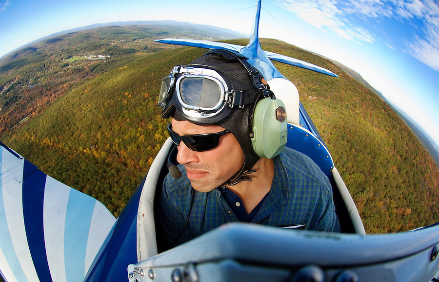 Pilot Chris Hand flies his 1941 biplane over the Catskills of Sullivan County in upstate New York on an early afternoon on October 7, 2006.