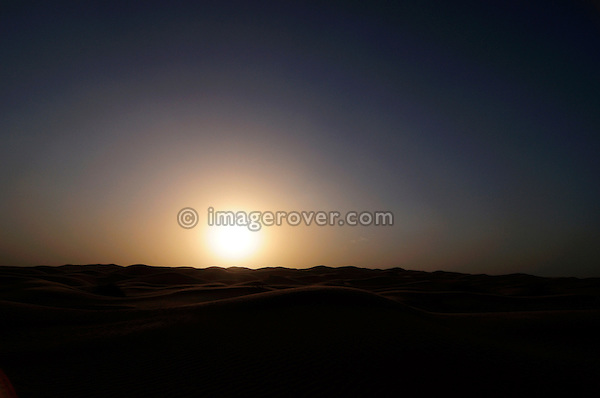 Africa, Tunisia, nr. Ksar Rhilane. Sunset in the sand dunes to the west of Ksar Ghilane on the eastern edge of the Grand Erg Oriental.