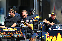Apr 11, 2015; Las Vegas, NV, USA; NHRA pro stock driver Larry Morgan with crew during qualifying for the Summitracing.com Nationals at The Strip at Las Vegas Motor Speedway. Mandatory Credit: Mark J. Rebilas-