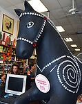 """Bedazzled"" by artists Mark Smith and Rick Heidemann, one of the 35 ""Rockin' Around Saugerties"" art works, this one seen in the Town and Country Liquors Store (owner Peggy Schwartz seen in rear) at 330 Rte 212, Saugerties, NY, on Friday, June 30, 2017. Photo by Jim Peppler. Copyright/Jim Peppler-2017."