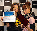 """Sony's VAIO director Ryosuke Akahane shows new pocket-size VAIO computer """"type P"""", comparing it with an envelope in Ginza on Thursday. 8 January, 2009. (Taro Fujimoto/JapanToday/Nippon News)"""