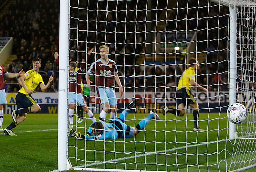 19.04.2016. Turf Moor, Burnley, England. Skybet Championship. Burnley versus Middlesbrough. Middlesbrough striker Jordan Rhodes turns away as he scores his side's first goal past keeper Heaten.