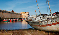 "Dry dock boat in the harbour with the defensive walls of the Portuguese Fortified city of Mazagan in the background, El Jadida, Morocco. El Jadida, previously known as Mazagan (Portuguese: Mazag""o), was seized in 1502 by the Portuguese, and they controlled this city until 1769. Picture by Manuel Cohen"