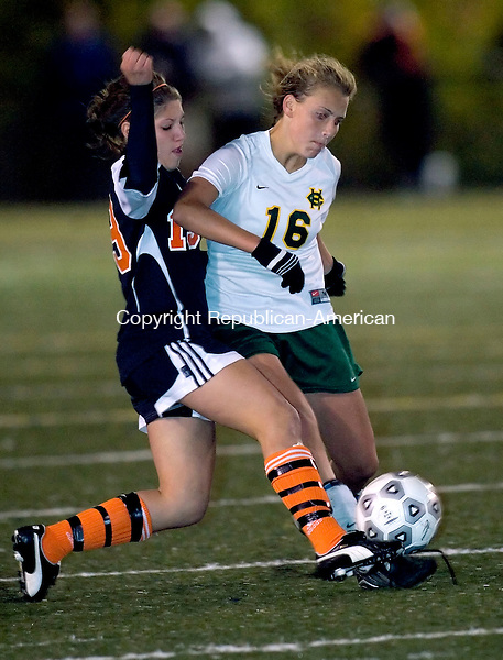 WATERBURY, CT- 07 OCTOBER 2008 --100708JS08--Holy Cross' Andrea Broderick (16) and Watertown's Sabrina Brundage (19) collide while both going for the ball during their game Tuesday at Municipal Stadium in Waterbury. <br /> Jim Shannon / Republican-American