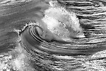 Black and white of wave curling over itself