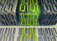 Line of bright binary code data standing out from grey rows