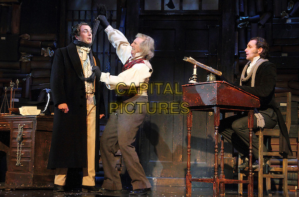 Craig Whitley, Tommy Steele as Ebenezer Scrooge & Edward Handoll.'Scrooge' at the London Palladium, London, England. .31st October 2012.on stage acting play performance performing acting full length white shirt red waistcoat grey gray trousers hands arms scarf mouth open cast dress gloves strangling around neck gesture mouth open.CAP/ROS.©Steve Ross/Capital Pictures.