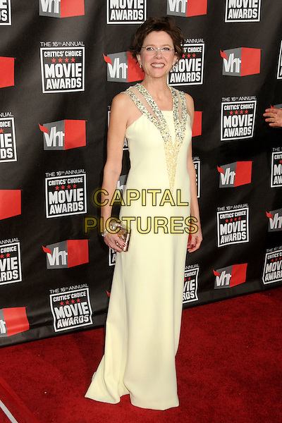 ANNETTE BENING .16th Annual Critics' Choice Movie Awards held at the Hollywood Palladium, Hollywood, California, USA, 14th January 2011..full length long maxi yellow dress clutch bag gold cream straps sequined sequin .CAP/ADM/BP.©Byron Purvis/AdMedia/Capital Pictures.