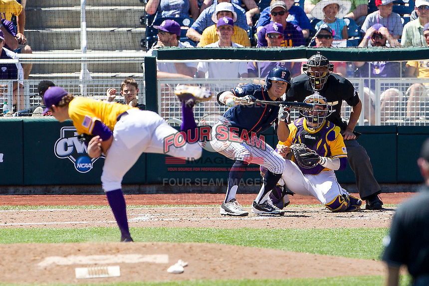 Cal State Fullerton designated hitter Davi Olmedo-Barrera (23) squares to bunt during the NCAA College baseball World Series against the LSU Tigers on June 16, 2015 at TD Ameritrade Park in Omaha, Nebraska. LSU defeated Fullerton 5-3. (Andrew Woolley/Four Seam Images)