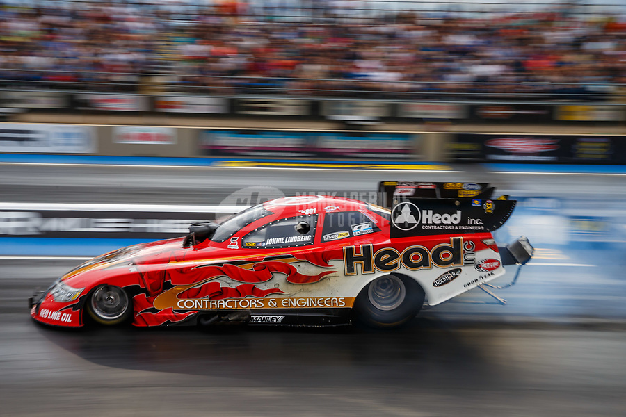 Jul 21, 2017; Morrison, CO, USA; NHRA funny car driver Jonnie Lindberg during qualifying for the Mile High Nationals at Bandimere Speedway. Mandatory Credit: Mark J. Rebilas-USA TODAY Sports