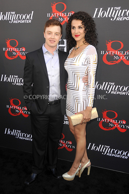 WWW.ACEPIXS.COM . . . . .  ....May 21 2012, LA....Noel Fisher (L) and guest at a special screening of 'Hatfields & McCoys' hosted by The History Channel at Milk Studios on May 21, 2012 in Hollywood, California. ....Please byline: PETER WEST - ACE PICTURES.... *** ***..Ace Pictures, Inc:  ..Philip Vaughan (212) 243-8787 or (646) 769 0430..e-mail: info@acepixs.com..web: http://www.acepixs.com