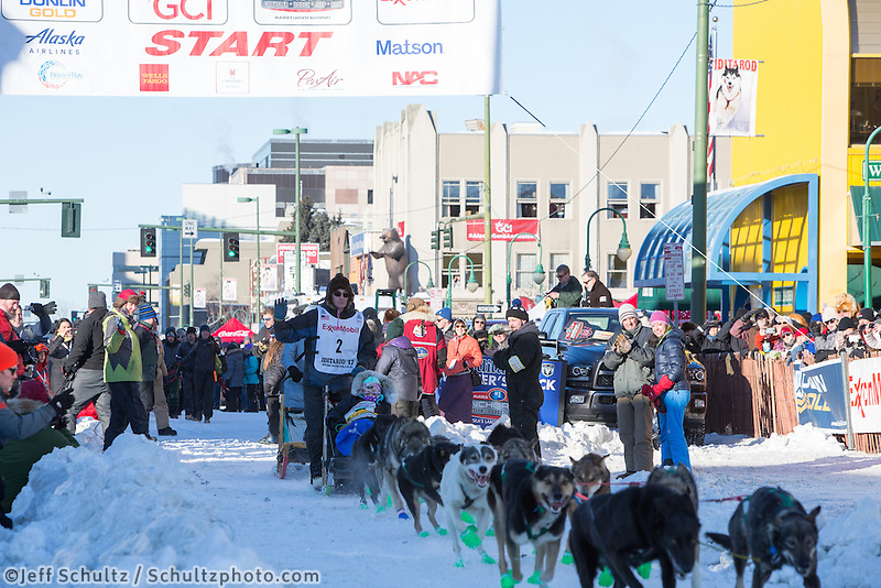 Ryan Redington and team leave the ceremonial start line with an Iditarider and handler at 4th Avenue and D street in downtown Anchorage, Alaska on Saturday March 4th during the 2017 Iditarod race. Photo © 2017 by Brendan Smith/SchultzPhoto.com.