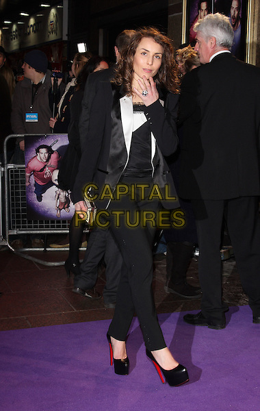 "NOOMI RAPACE.The ""Paul"" UK Film Premiere, Empire Cinema, Leicester Square, London, England, UK, 7th February 2011.full length black platform shoes heels christian louboutin trousers suit jacket blazer white top clutch bag hand over mouth lace .CAP/ROS.©Steve Ross/Capital Pictures..."
