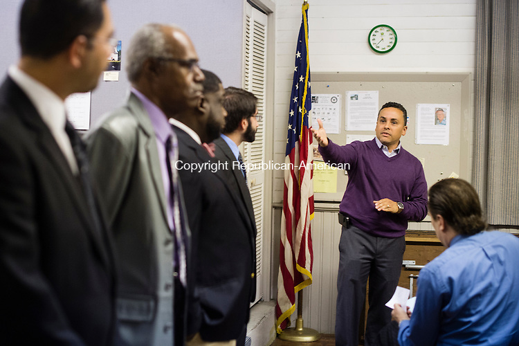 WATERBURY, CT - 27 October 2015-102715EC09-- Victor Lopez, Jr. makes a point while candidates in the 2nd aldermanic district of Waterbury look on. From L to R: Ruben A. Rodriguez, Gregory A. Hadley, Sr., Robert Fields, Francis Guerrera and, sitting, is Alan Couture. The Bucks Hill Community Club hosted Tuesday night's event. A little over a dozen people attended. Erin Covey Republican-American.