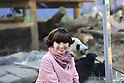 Tetsuko Kuroyanagi poses beside a female giant panda Shin Shin at Ueno Zoo