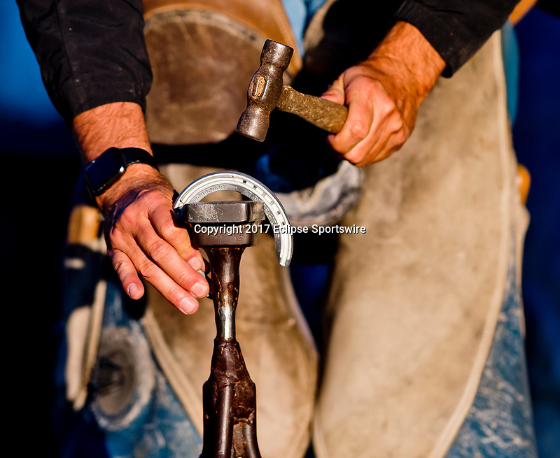 LOUISVILLE, KENTUCKY - MAY 02: A farrier works on a horseshoe on the backside during Kentucky Derby and Oaks preparations at Churchill Downs on May 2, 2017 in Louisville, Kentucky. (Photo by Scott Serio/Eclipse Sportswire/Getty Images)