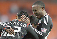 Cristian Castillo #12 and Rodney Wallace #22 of D.C. United congratulate Andy Najar #14 for his goal during a US Open Cup match against F.C. Dallas on April 28 2010, at RFK Stadium in Washington D.C. United won 4-2.