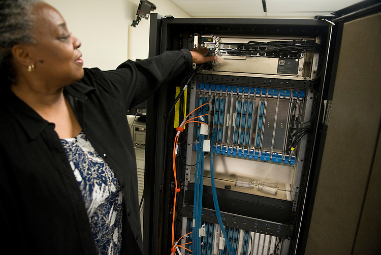 Gloria Washington, senior operating technician, Ford Data Center, explains how she shut down the House's last main frame computer at Ford House Office Building, Oct. 9, 2009.