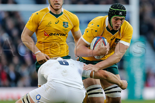 03.12.2016. Twickenham, London, England. Autumn International Rugby. England versus Australia.  Rob Simmons of Australia is tackled by Chris Robshaw of England.   Final score: England 37-21 Australia.