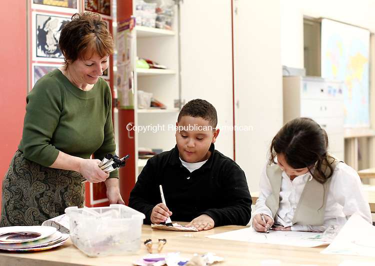 Waterbury, CT- 21 March 2014-032114CM02-  Rotella Magnet School art teacher Suzanne Dionne helps students, Robert Spardaro, 6, and Luxarii Rivera, 6, with an art project during class on Friday.  Dionne has won a national educator award.   Christopher Massa Republican-American