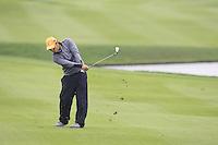 He Ze-yu (CHN) plays his 3rd shot on the 13th hole during Sunday's Final Round of the 2014 BMW Masters held at Lake Malaren, Shanghai, China. 2nd November 2014.<br /> Picture: Eoin Clarke www.golffile.ie