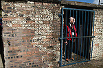 Harestanes AFC v Girvan FC, 15/08/2015. Scottish Cup preliminary round, Duncansfield Park. A club official inspecting the turnstiles before Harestanes AFC take on Girvan FC in a Scottish Cup preliminary round tie, staged at Duncansfield Park, home of Kilsyth Rangers. The home team were the first winners of the Scottish Amateur Cup to be admitted directly into the Scottish Cup in the modern era, whilst the visitors participated as a result of being members of both the Scottish Football Association and the Scottish Junior Football Association. Girvan won the match by 3-0, watched by a crowd of 300, which was moved from Harestanes ground as it did not comply with Scottish Cup standards. Photo by Colin McPherson.