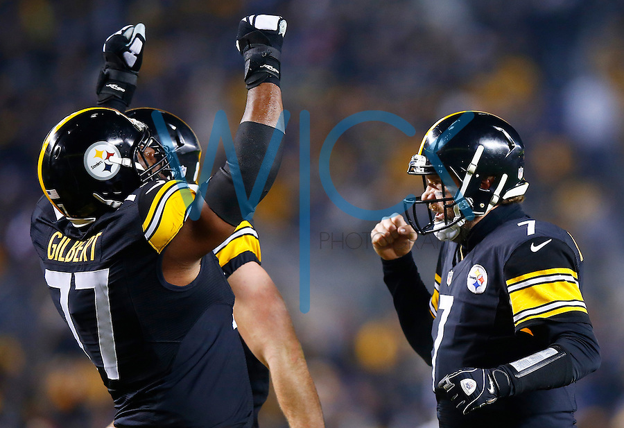 Ben Roethlisberger #7 of the Pittsburgh Steelers celebrates with teammate Marcus Gilbert #77 of the Pittsburgh Steelers following a touchdown late in the second quarter against the Indianapolis Colts during the game at Heinz Field on December 6, 2015 in Pittsburgh, Pennsylvania. (Photo by Jared Wickerham/DKPittsburghSports)