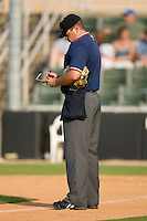 Home plate umpire Ryan Carle updates his lineup card during a South Atlantic League game between the Rome Braves and the Kannapolis Intimidators at Fieldcrest Cannon Stadium July 26, 2009 in Kannapolis, North Carolina. (Photo by Brian Westerholt / Four Seam Images)