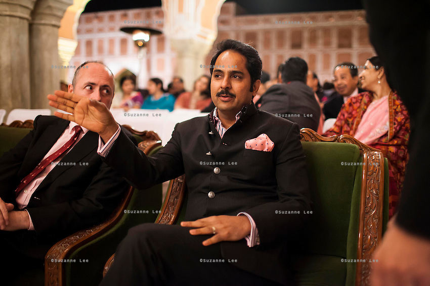 (L-R) Dr. Lachlan Strahan, Australia's High Commissioner to India, and Maharaj Narendra Singh, Maharaj of Jaipur, sit together as they await the beginning of the violin recital by Australian violinist Niki Vasilakis at the OzFest Gala Dinner in the Jaipur City Palace, in Rajasthan, India on 10 January 2013. Photo by Suzanne Lee