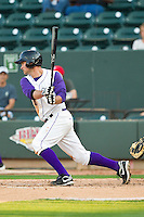 Jeremy Farrell (15) of the Winston-Salem Dash follows through on his swing against the Frederick Keys at BB&T Ballpark on May 28, 2013 in Winston-Salem, North Carolina.  The Dash defeated the Keys 17-5 in the first game of a double-header.  (Brian Westerholt/Four Seam Images)
