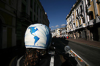 Ivan Pisarenko rides through dowtown Quito, Ecuador, August 2008..Born in Argentina, photographer Ivan Pisarenko in 2005  decided to ride his motorcycle across the American continent. While traveling Ivan is gathering an exceptional photographic document on the more diverse corners of the region. Archivolatino will publish several stories by this talented young photographer..Closer look at  Ivan's page www.americaendosruedas.com....