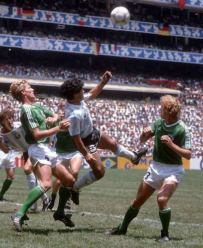 29.06.1986. Estadio Azteca, Mexico City, Mexico. FIFA World Cup final, Germany versus Argentina. Diego Armando Maradona (Arg) challenges Karl-Heinz Foerster and Andreas Brehme (Ger)