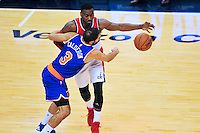 Jose Calderon of the Knicks pokes the ball away from Wizards John Wall. New York defeated Washington 115-104 during a NBA preseason game at the Verizon Center in Washington, D.C. on Friday, October 9, 2015.  Alan P. Santos/DC Sports Box